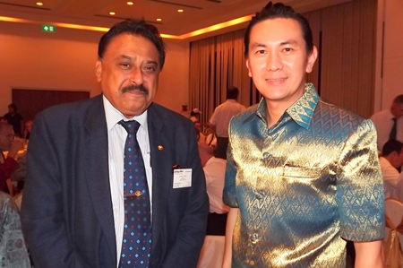 Peter Malhotra (left), managing director of Pattaya Mail, poses for a photo with Saksit Potisit, spokesman for City Hall.