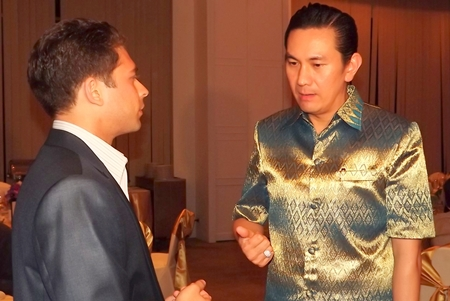 Karan Khanijou (left), vice president in charge of investment sales for Jones Lang LaSalle Hotels, chats with Saksit Potisit, spokesman for City Hall.