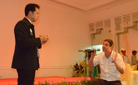 Uli Kaiser from Automotive Manufacturing Solutions poses a question for Mayor Itthiphol Kunplome.