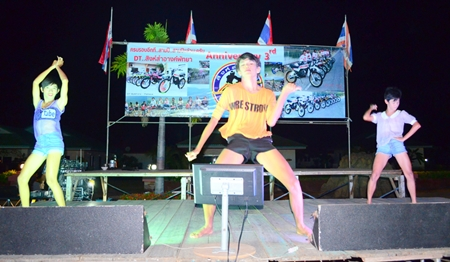 A dance troupe of young boys provides the stage entertainment.