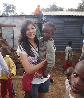 Anita playing with local children.