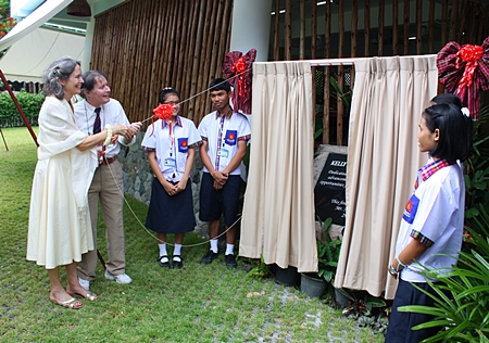 Mathew and Mary Kelly pull back the curtains to reveal the honorary plaque and officially announce the new school is open.
