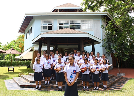 """The """"biggest ukulele band in Thailand"""" performs for the honored guests in front of the new school."""