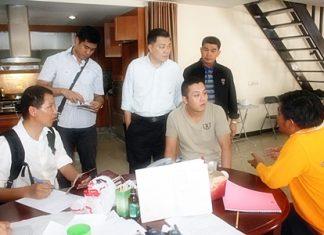 Police investigators interrogate alleged ringleader Liu Jian (seated, center) from Anhui, China.