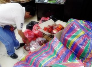 Police sort through the unlicensed, untaxed merchandise.