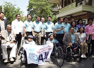 Local officials, including Capt. Pisan Wattanawongsiri (back row, 4th left), honorary consultant of Redemptorist Center for People with Disabilities, launch the ceremony.