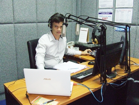 Station manager Panthakan Phromprangkun works the morning show.