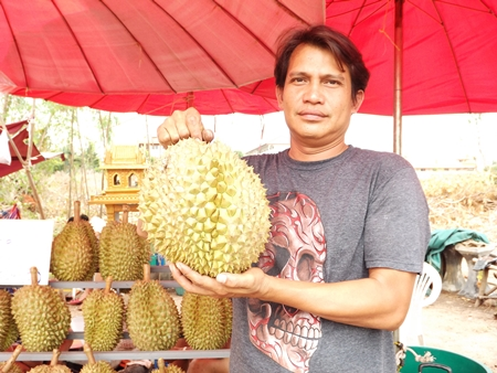 Vendor Direk Khaewdum sells his durian at the Hollywood three-way intersection in North Pattaya.