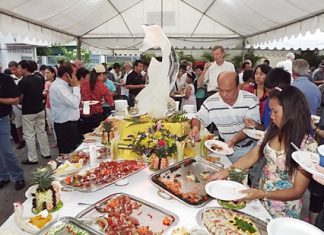 Guests dig in to the delicious food and wine laid out for the occasion.