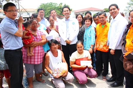 Mayor Itthiphol Kunplome and Social Welfare Department officials visit the area to offer emergency supplies and cash to the victims.
