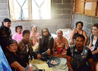 Chaiyos Chaloawanarat, leader of the Yo Middle Way motorcycle club and a handful of bikers visit the stricken family.