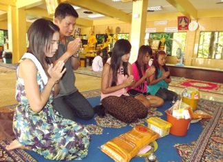 Buddhists making merit, making religious offerings to the temple before Visakha Bucha Day arrives.