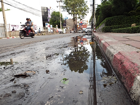 Stagnant water on Pattaya Second Road, Soi 6, over 7 m long and 4 cm deep.