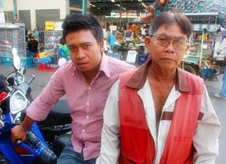 Manop Chaiyapat (left) and friend Kraisorn Poto, a motorcycle taxi rider who works around the New Naklua market, want the mayor to seriously clear drugs off the street.