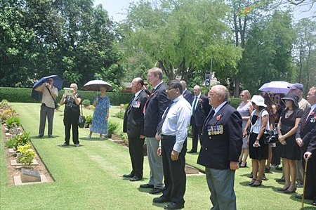 The Wreath Layers at Chungkai (from right) Maurice Hewson, the British Ambassador, Tony Archer and Fred Beavis.