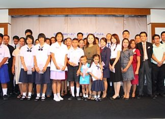 Hotel Assistant General Manager Sompong Wattana (center, green dress) presents 27 scholarships worth 98,500 baht to hotel employees for their children.