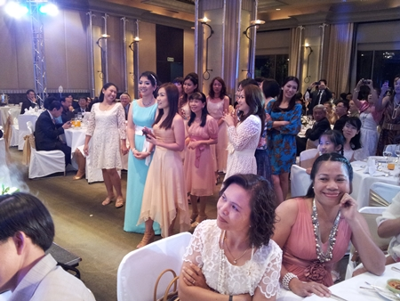 The young ladies wait impatiently for the throwing of the bouquets.