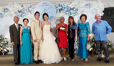 (From left) Samphan Akrapongpanich, Radchada Chomjinda, the bridal couple Ning and Nok, Laurence Futon, Sheree Wilkies, Thanaporn Cheumthong and Philipp Wilkies.