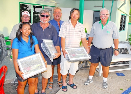 The third placed team, Ken Berneck, Henry Wong, Bo Cardwell and Mike Winfield, receive their awards from the 'Admiral' and Peter Blackburn.