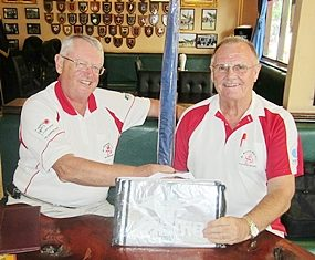 Dick Warberg, left, presents the MBMG 'golfer of the month' award to Derek Brook.