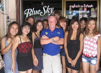 Andy M and staff outside the Blue Sky Bar.