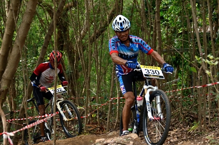 Cyclists get to grips with one of the tough off-road sections.