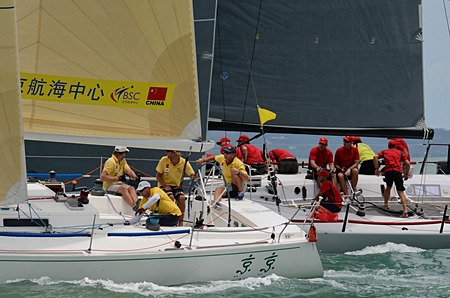 """""""Jing Jing"""" and """"KukuKERchu"""" battle for position in the IRC 1 Class on Race Day 2."""