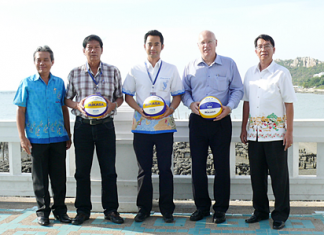 Narongchai Khunpluem, Mayor of Saensook Municipality, centre, and Geoffrey Rowe, Managing Director of Pentangle Promotions Co., Ltd., 2nd right, pose with other local dignitaries to announce the 2012 Bangsaen Thailand Open beach volleyball tournament.