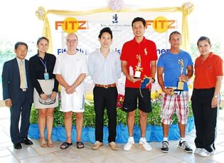 Winners of the first Fitz Club tennis tournament are presented with their trophies.