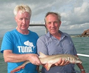 Peter Holt and Dave Chilton pose with their shared catch.