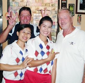 Flight winners John Hacket-and Barry Elphick with two of Bert's helpers