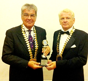 Dale Lawrence (left) and Andrew Wood pose with the award.