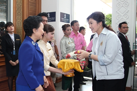 """Panga Vathanakul (left), Managing Director of Royal Cliff Hotels Group welcomes Prime Minister Yingluck Shinawatra and her cabinet upon their arrival at the hotel for the 5th Mobile Cabinet Meeting, held on June 17-19. Panga Vathanakul proudly said, """"It is certainly a privilege to be part of such an important occasion. We are elated to have had this opportunity to have looked after our nation's leaders."""""""