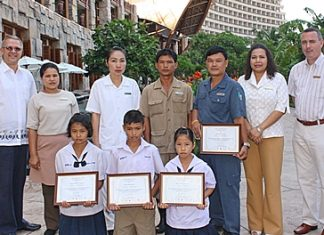 Andre Brulhart (left), GM of the Centara Grand Mirage Beach Resort, Pattaya presided over the annual Centara Grand Mirage scholarships presentation 2012 ceremony recently. The event was organized by Daranart Nuchaikaew (2nd right), director of human resources of the hotel for the benefit of the children of hotel staff. Others attending the happy occasion included Boonmee Polyos, room attendant; Suchanya Noptakul, tailor; Thavorn Kongtangam, gardener; Thongchai Kanchentorn, technician, Daranart and Paulo De Matos (far right), executive assistant manager on rooms.