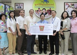 Andre Brulhart (4th left), GM of the Centara Grand Mirage Resort Pattaya presents a donation of 20,000 baht to Father Pattarapong Srivorakul (3rd right), chairman of Father Ray's Foundation and Father Dr. Picharn Jaiseri (centre), the vice chair. The funds were raised during the 9th anniversary celebrations of Zico's Restaurant last month.