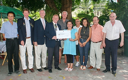 At a small ceremony held at the Norwegian Church recently, Gudmund Eiksund, president of the Rotary Club of Jomtien-Pattaya together with fellow members Vutikorn Kamolchote, Jan Olav Aamlid and Dieter Reigber presented a donation of 100,000 baht to Piangta Chumnoi, director of the Ban Jing Jai Foundation. On hand to receive the donation were members of the building committee Hans K. Nyvoll, Stephen and Lamyai Beard, Jim Farmer, and John Haerum.