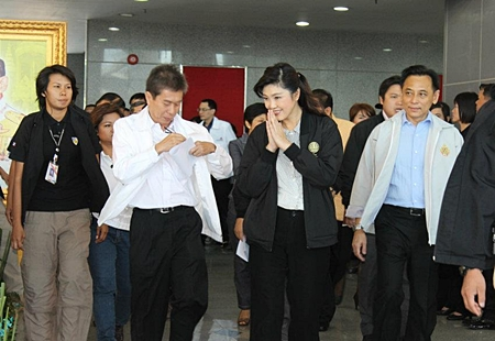 Prime Minister Yingluck Shinawatra visits Laem Chabang Port to listen to expansion plans.