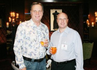 Simon Matthews (country manager for Thailand Manpower Group) and David Cumming (director of BCCT) sip some amber liquid together.
