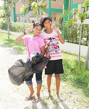 Some of the children keep busy happily collecting rubbish on the land.