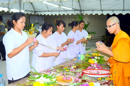 Buddhists prepare offerings to be used in the Wien Thien ceremony at Wat Khao Phra Yai.