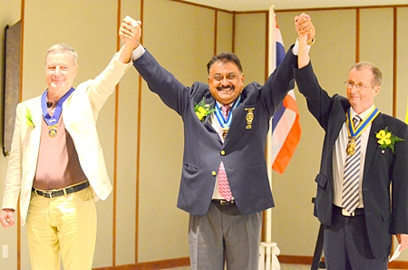 PDG Peter proclaims Joseph Roy (right) as president and Yves Echement as past president.