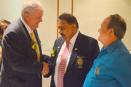 Hubert Meier (left) president of the Rotary Club Phoenix Pattaya greets PDG Peter Malhotra and PDG Premprecha Dibbayawan (right).