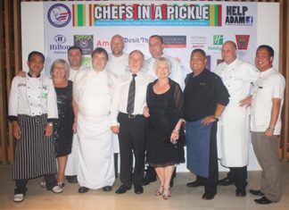 Tracy Cosgrove (2nd left) and Andrew & Adele Pickles (center) pose with the chefs that made the charity evening great.