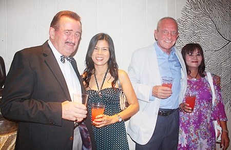 John Collingbourne and Yada Ruairuen from Collingbourne Auctioneers, toast with Roger Mynott, owner of Thai Decor Company and Somnuk Tunkratok.