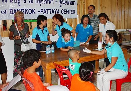 Dr. Natnicha Loichuen, specialist medical professional and member of YWCA Bangkok-Pattaya Center, provides check-ups for the kids.