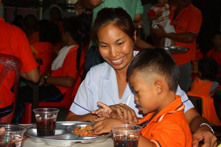 Friends and teachers feed the children lunch during the special visit.