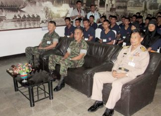 Children from Thailand's strife-torn southern provinces sit behind navy brass during a stop in their tour.