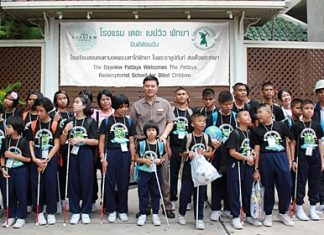 Nijjaporn Marprasert (center) welcomes young blind students to the Siam Bayview Hotel.