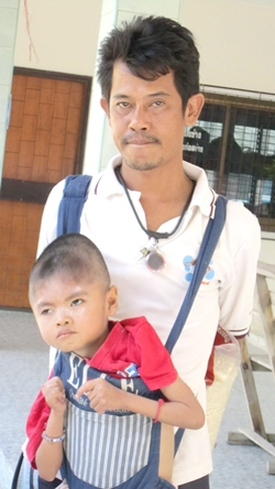 Previously, Somchai had to get around on his motorbike with his 8-year old son, Flook, strapped to his shoulders in front of him in an infant carrier.