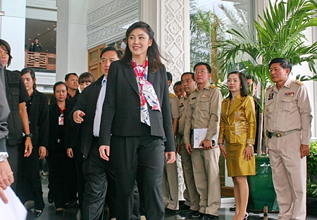 Prime Minister Yingluck Shinawatra arrives at the Royal Cliff for her second day of meetings.